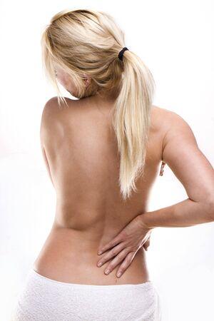 back of woman: belleza rubia mujer el dolor de espalda Foto de archivo