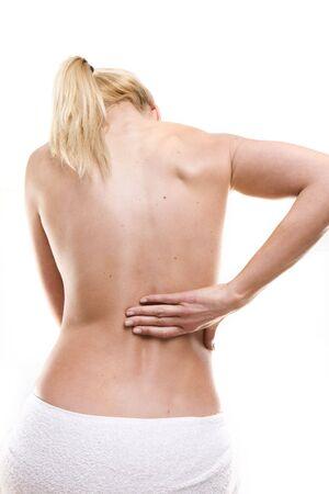 dolor de estomago: belleza rubia mujer el dolor de espalda Foto de archivo