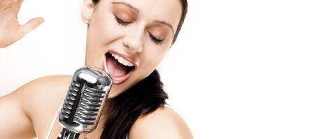 shure: sexy singer with retro microphone singing  Stock Photo