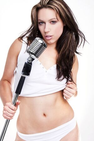 female singer: sexy glamour pop star singer with white lingerie and retro microphone