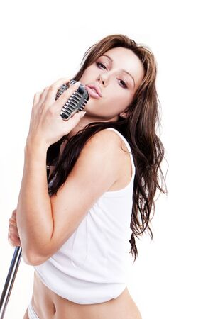 sexy glamour pop star singer with white lingerie and retro microphone  photo