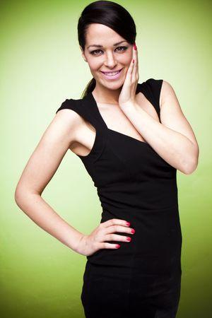 sexy fashion brunette woman in black dress photo