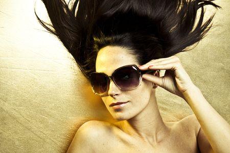 Portrait of beautiful young sexy woman wearing sunglasses  Stock Photo - 5004289