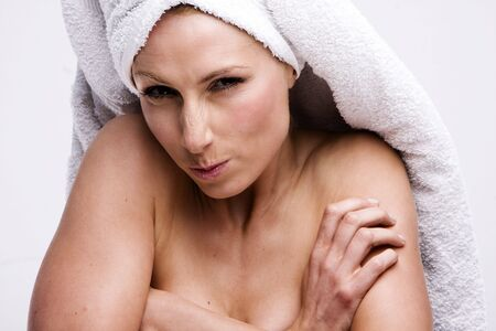 bathtowel: frustrated house wife wearing white  towel Stock Photo