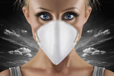 protective face mask on scared blue eyes woman on dark sky background  photo