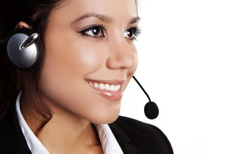 Closeup of a beautiful, young brunette woman with headset Stock Photo - 5004309