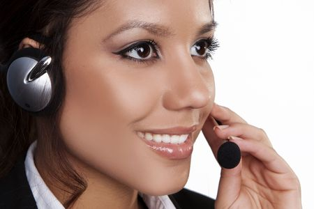Closeup of a beautiful, young brunette woman with headset Stock Photo - 5004301