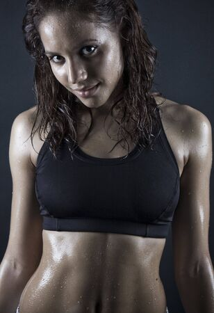 brunette woman smiling after workout . wet hair  photo