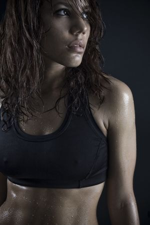 beautiful fitness body passion for exercising. exhausted brunette after workout photo