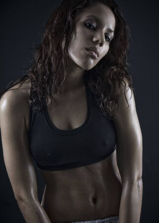 beautiful fitness body . exhausted brunette after workout photo
