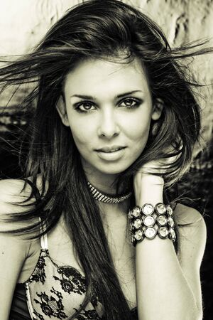 Black & White portrait of the mysterious, beautiful, sexy, brunette girl with jewelery   photo