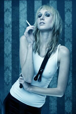 Beautiful smoking woman over abstract vintage wallpaper photo