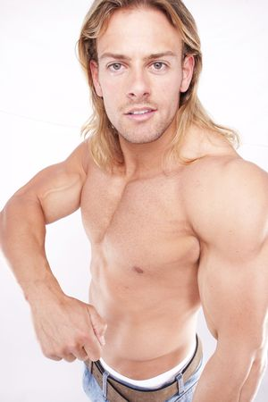 Athletic sexy male body builder with the blond long hair. gladiator photo