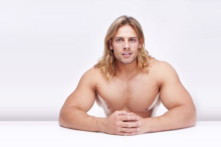 arms body: Athletic sexy male body builder with the blond long hair. gladiator