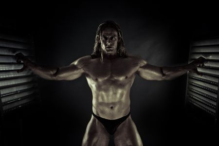 muscularity:  Super Hero in the Cage Stock Photo