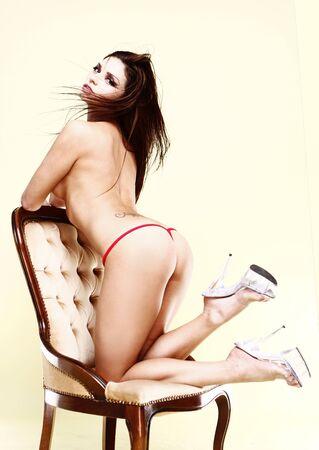 Studio fashion portrait of a beautiful young woman with long dark hair in red bikini on stylish hair Stock Photo - 5057844