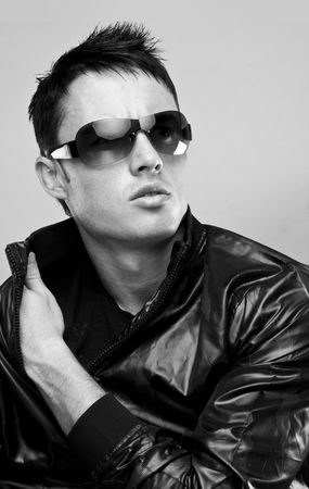 sunglasses isolated: fashion male brunette portrait wearing black jacket and sunglasses