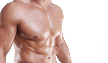 atrophy: Muscular male torso isolated on white Stock Photo