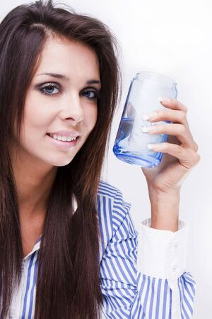 Portrait of beautiful young woman with glass of water photo