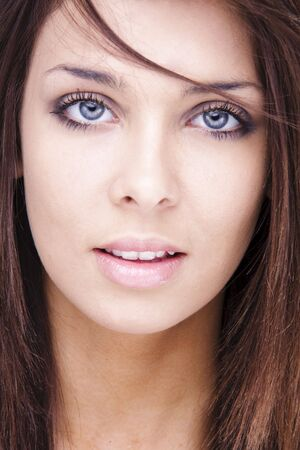 Portrait of young adult woman with health skin of face and blue eyes photo