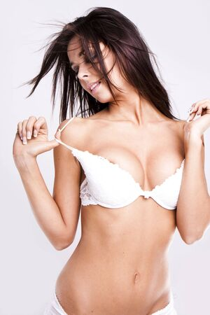 Sexy lady taking off her clothes  Stock Photo
