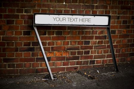Place your text here - empty ad place at the street - brickwall background  Stock Photo - 5158700