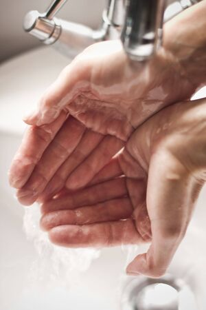 Washing hands under tap Stock Photo - 5158696