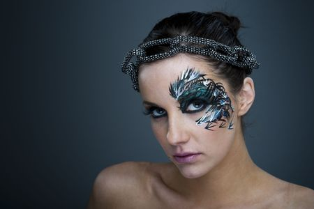 Girl with beautiful artistic face painting - make up  photo