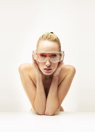 nude blond model on isolated background wearing glasses . Sexy naked blond girl Stock Photo - 5246649