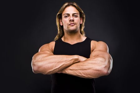 muscular male: Sexy muscular man isolated on black Stock Photo