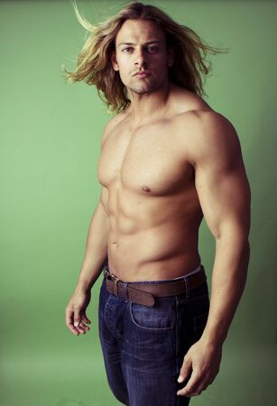 human chest: athletic sexy male body builder with the blonde long hair