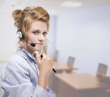 Woman wearing headset indoors in the office  photo