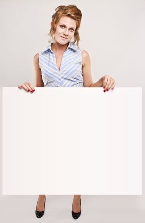 Attractive secretary over white empty board, lots of copyspace Stock Photo - 5246382