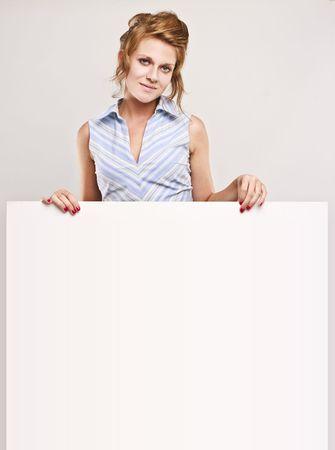 Attractive secretary over white empty board, lots of copyspace Stock Photo - 5246381