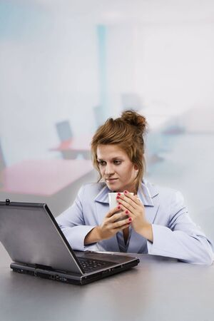 Woman with laptop drinking coffee Stock Photo - 5246725