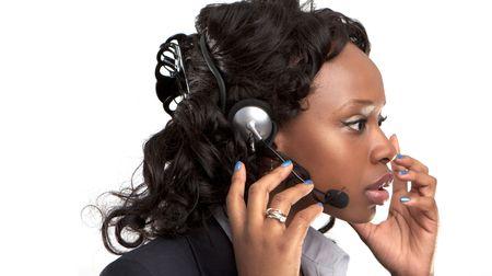 dgf15:  studio shot of a smiling businesswoman talking on a customer service telephone headset.