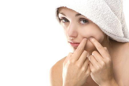 revolting: Pimple , spot on beauty woman face with a white towel Stock Photo
