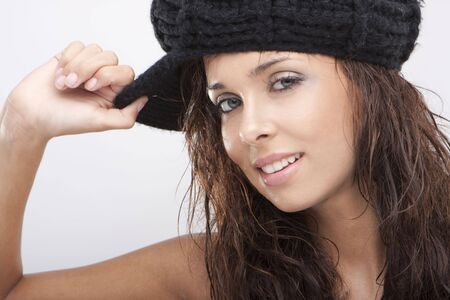 Close up of a beautiful young woman smiling wearing black hat  Stock Photo - 5302856
