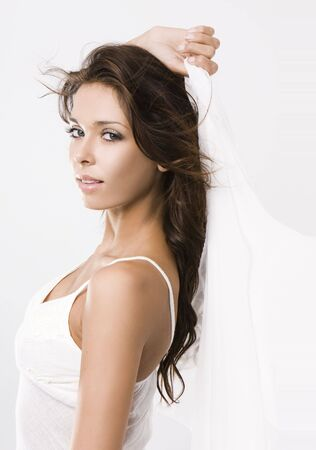 ttractive: Portrait of beautiful woman holding white dress