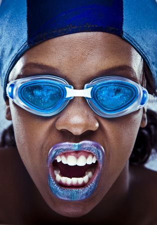 black girl wearing swimmin googles and hat with violet lips. artistic make-up shoot   photo