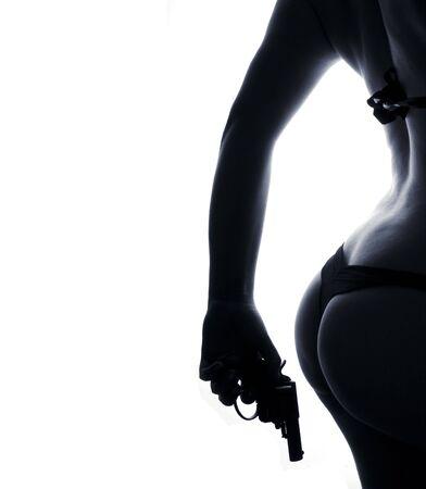 beautiful feminine bottom  with the pistol against white background