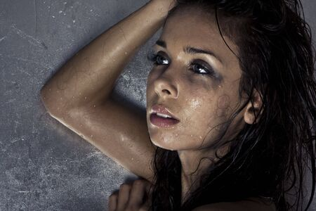 sexy model with wet and dirty skin and hair taking a shower Stock Photo - 5485418
