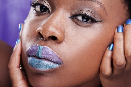 african woman face: beauty african face with violet lips and nails Stock Photo