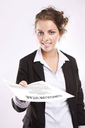 Young attractive woman handing over her CV on white background  photo