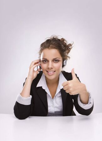 Pretty young business woman having a sucesfull conversation over the mobile photo