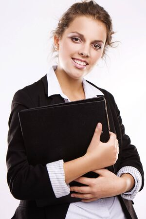 young smiling businesswoman or student with folder smiling