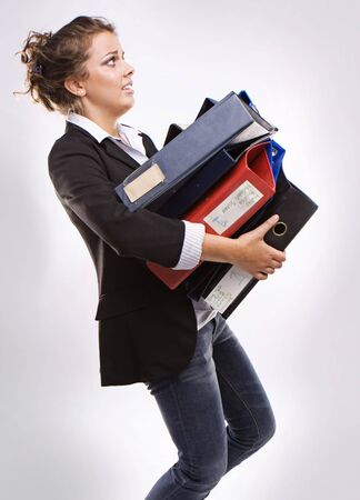 busy business woman with folders of folders with documents  photo