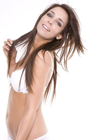 Beautiful young smiling woman in white sexy lingerie with wind in her hairs isolated on white background Stock Photo - 5752612