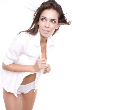 sexy brunette glamour model wearing white shirt and sexy lingerie pants isolated Stock Photo - 5752608