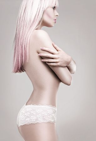 Girl in white panties and pink blonde hair - side view studio shoot photo